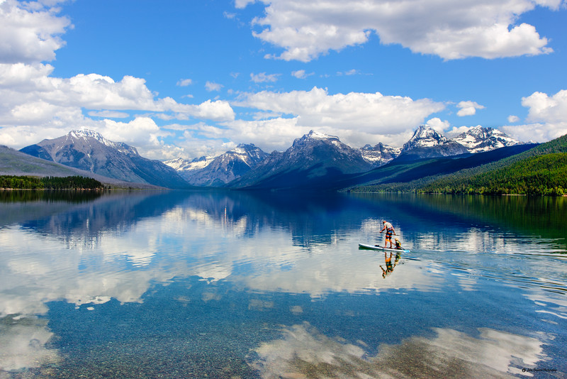 Dad and his son paddleboarding on Lake McDonald in Glacier National Park - 2