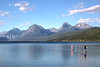 Couple paddleboarding on Lake McDonald in Glacier National Park
