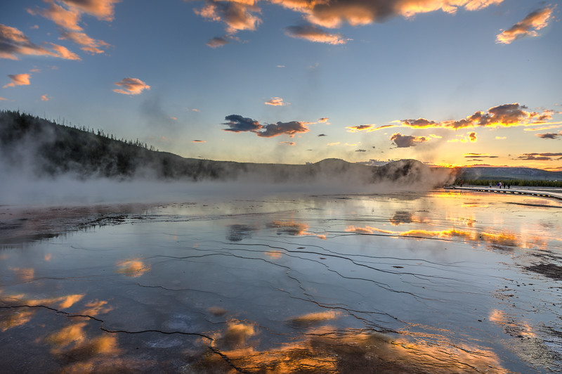 Sunset over the Grand Prismatic Spring in Yellowstone National Park which is the largest hot spring in the United States