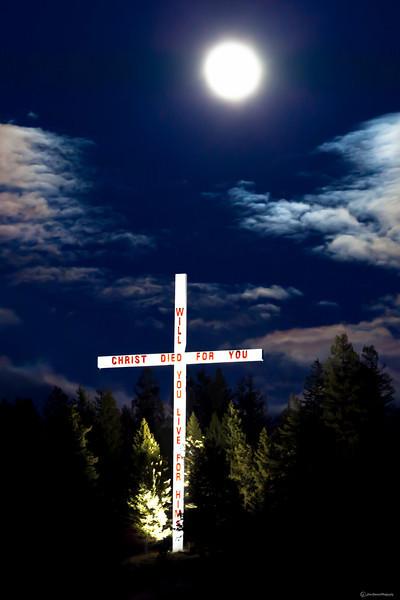 Light in the Darkness - Cross along highway 82 near Big Fork, Montana