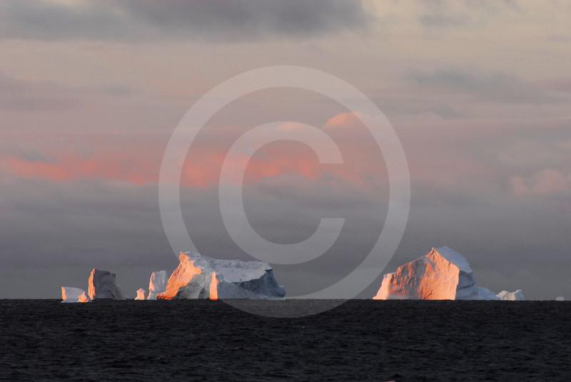 (305) Icebergs at sunset