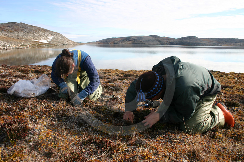 (21) Scientists taking soil sample
