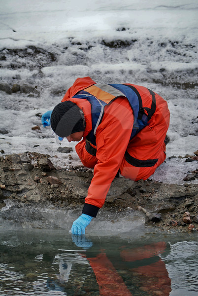(236) ArcticNet scientist sample the melt water flowing from a glacier in Makinson Inlet, Ellesmere Island, Nunavut