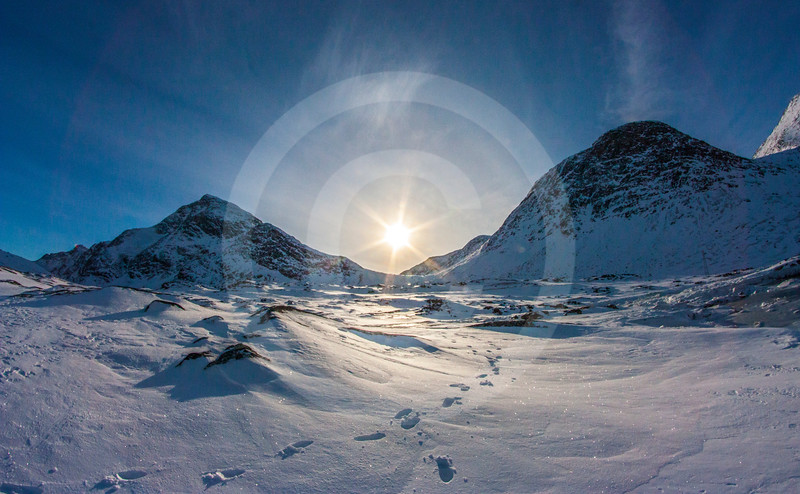 (1035) The low Arctic sun divides two mountains and illuminates our footprints