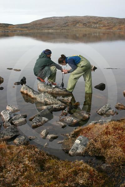 (146) Scientists taking oxygen measurements in lake