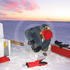 (60) Scientists sampling an ice core
