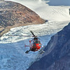 (286) The Amundsen's helicopter flying in Gibbs Fjord, Baffin Island, Nunavut