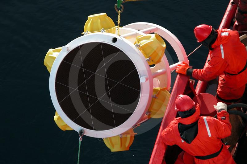 (22) Scientists deploying a sediment trap