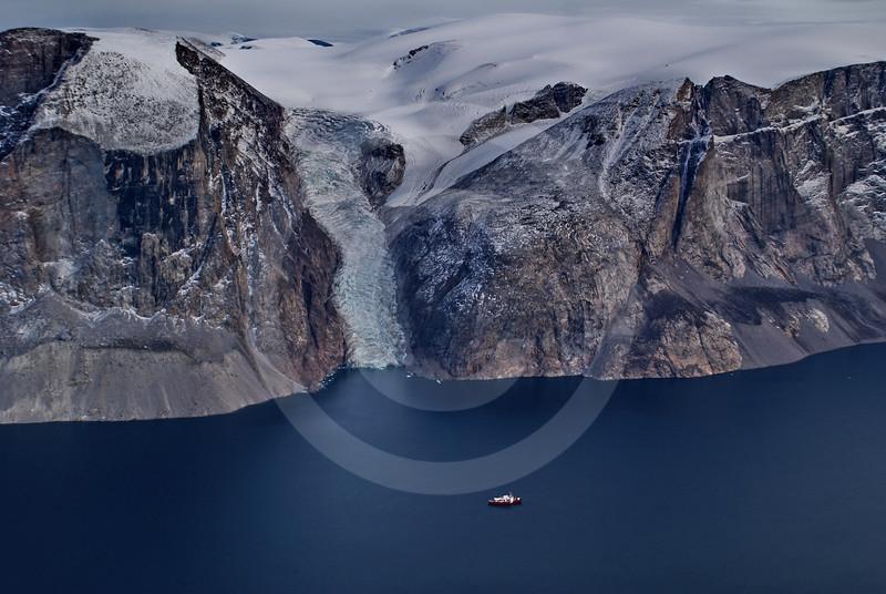 (218) The CGGS Amundsen sailing the majestic Gibbs Fjord, Baffin Island, Nunavut