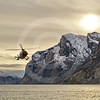 (282) The Amundsen's helicopter flying in Gibbs Fjord, Baffin Island, Nunavut