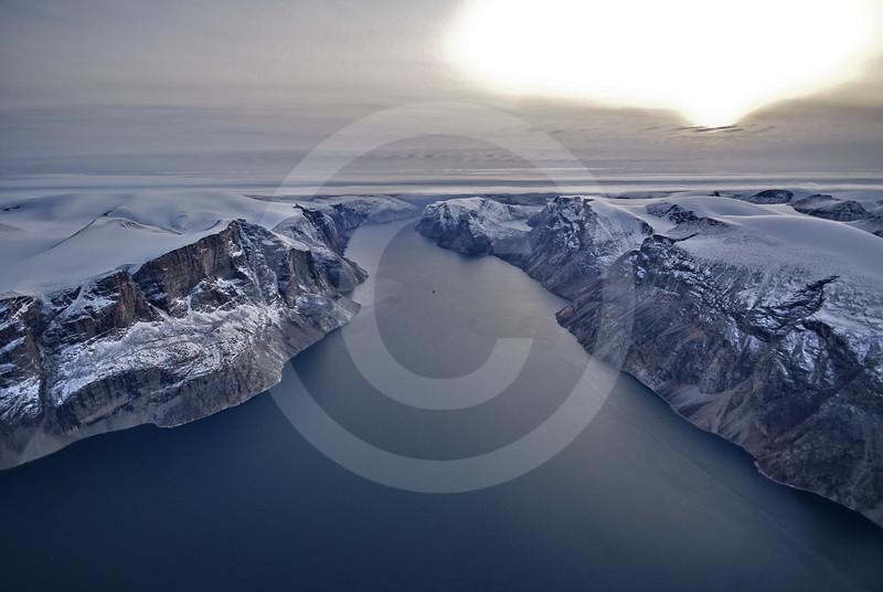 (216) The CCGS Amundsen sailing the majestic Gibbs Fjord, Baffin Island, Nunavut