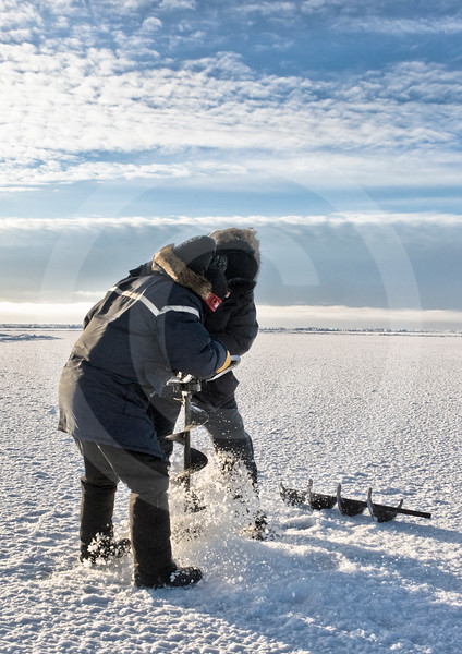 (343) Scientists drilling into the thick pack ice to measure ice thickness during the CFL program