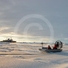 (139) Scientists in airboat taking ice measurements