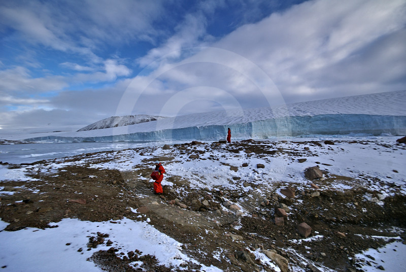 (245) ArcticNet scientist sample the melt water flowing from a glacier in Makinson Inlet, Ellesmere Island, Nunavut
