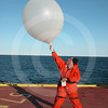 (46) Scientist preparing to launch a weather balloon