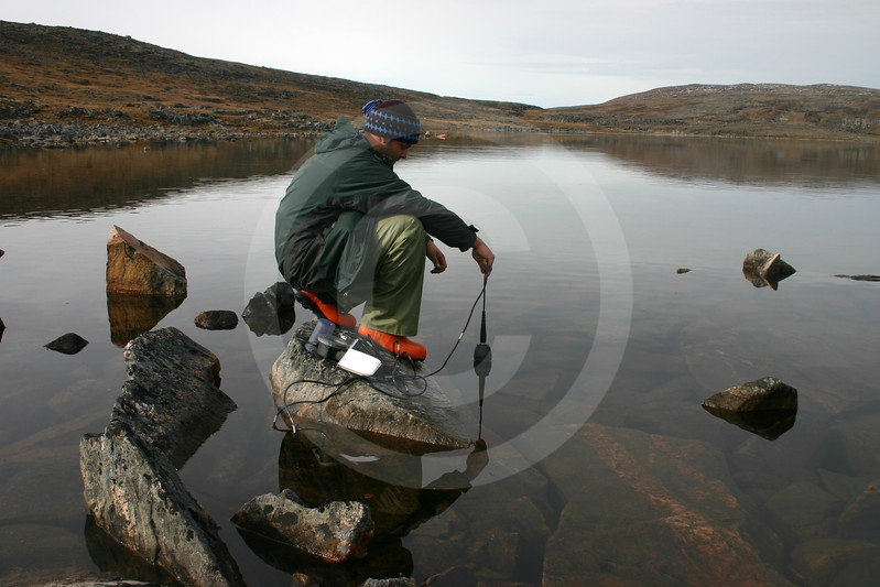 (20) Student taking measurement in Arctic lake