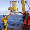 (93) Scientists recovering a sediment trap from a mooring