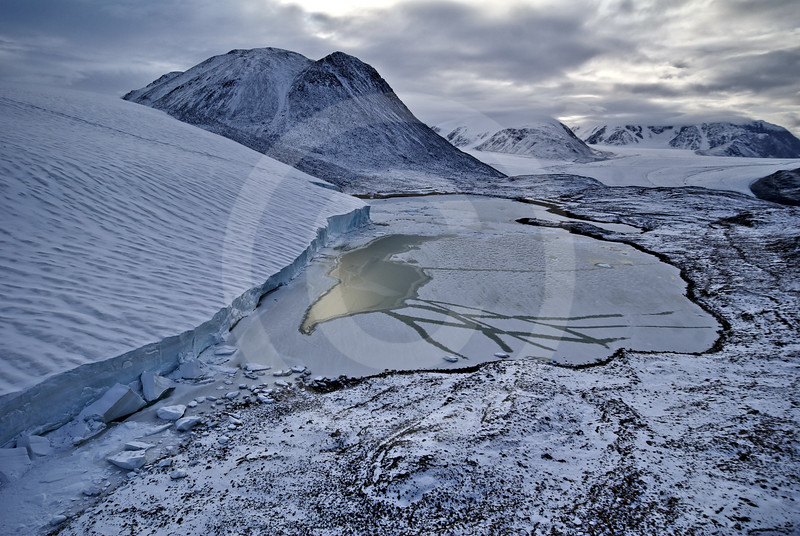 (243) Meltwater lake at the head of a glacier overlooking Makinson Inlet, Ellesmere Island, Nunavut