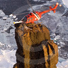 (329) The Amundsen's helicopter seems to have landed on top of a peculiar rock feature during a survey of the coastline