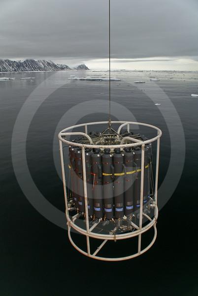 (253) The CTD-Rosette sampler deployed in the coastal waters of Ellesmere Island, Nunavut