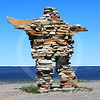 (681) Giant inuksuk in Kuujjuarapik, Nunavik, overlooking ice-covered Hudson Bay