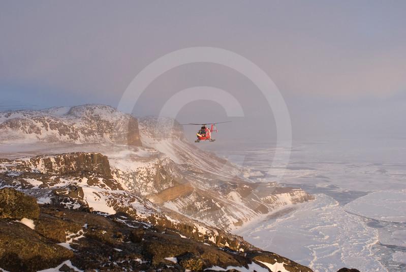 (330) The Amundsen's helicopter surveying the coastline