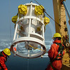 (28) Scientists and crew members deploying a sediment trap from the CCGS Amundsen