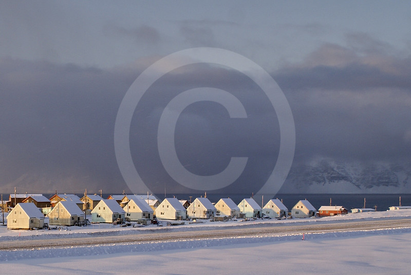 (228) The community of Pond Inlet on the northern tip of Baffin Island overlooks the majestic Bylot Island, Nunavut