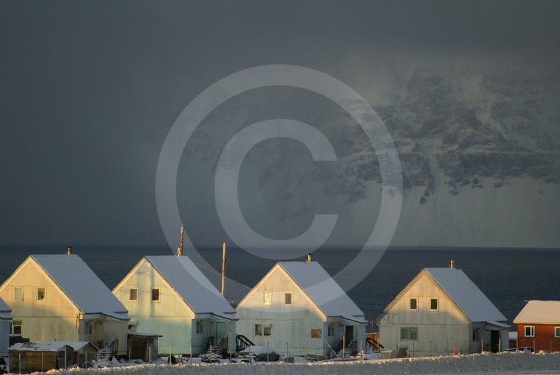 (230) The community of Pond Inlet on the northern tip of Baffin Island overlooks the majestic Bylot Island, Nunavut
