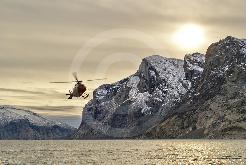 (282) The Amundsen's helicopter flying in Gibbs Fjord, Baffin Island, Nunavut