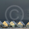 (229) The community of Pond Inlet on the northern tip of Baffin Island overlooks the majestic Bylot Island, Nunavut