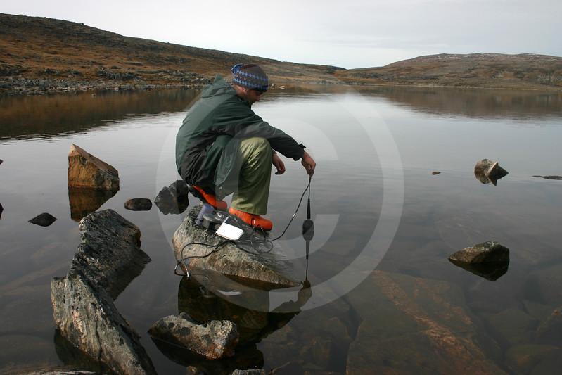 (20) Student taking measurement in Arctic lake