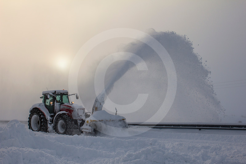 (2318) Farmer cleaning the road from snow in the afternoon sun