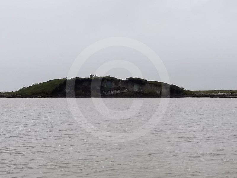 (2211) Pingo eroding due to climate change and coastal erosion