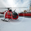 (111) Coast Guard helicopter on ice floe with CCGS Pierre Radisson in the background