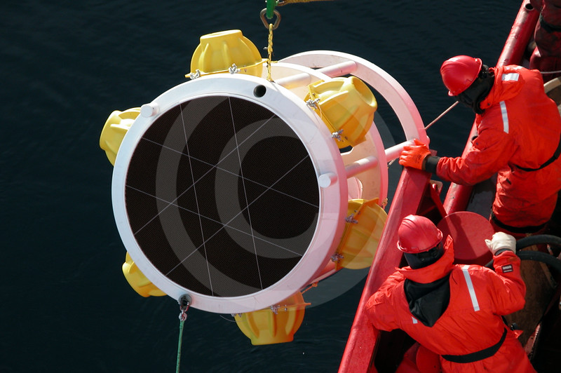 (22) Scientists deploying a sediment trap