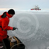 (31) Scientist taking ice measurement