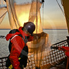 (553) ArcticNet scientists rinsing a plankton net on board the CCGS Amundsen in the Beaufort Sea