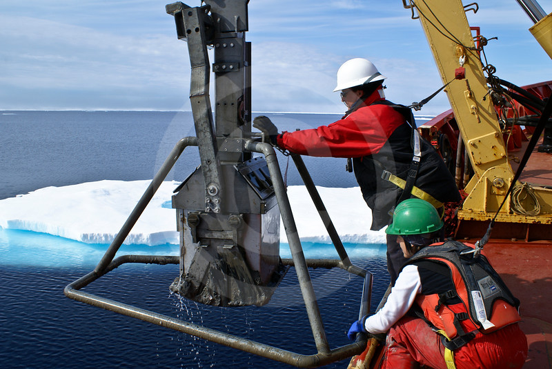 (316) Scientists sampling sediments in the Beaufort Sea using a box corer deployed from the CCGS Amundsen