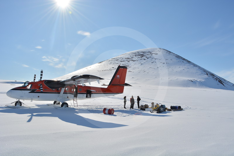 (2387) Unloading material from the Twin Otter