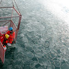 (52) Scientists sampling sea ice