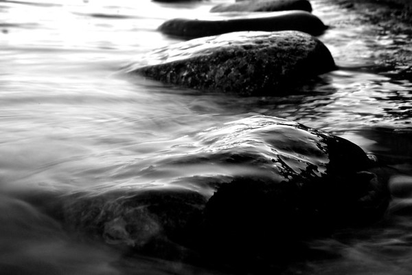 water slipping over stone