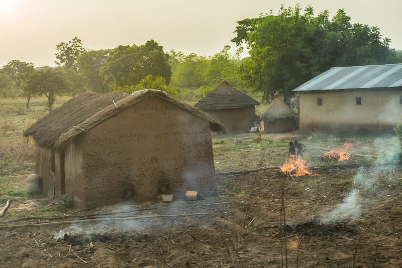 Sunset. Kids playing with the fire. Benin country side.