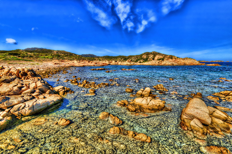English: Emerald Coast, Sardinian: Monti di Mola - is a coastal area and tourist destination in northern Sardinia, 55 km long and covering more than 30 km². With white sand beaches, a golf club, private jet and helicopter service, and hotels costing up to 2,000.- EUR per night in the peak season, the area has drawn celebrities, business leaders and other affluent visitors. <br /> Each September the Sardinia Cup sailing regatta is held off the coast.