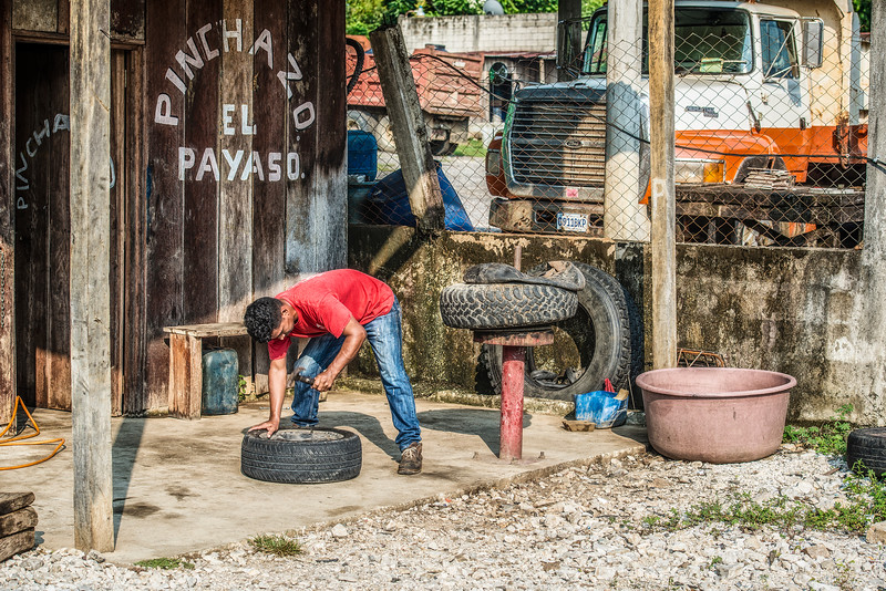 """The """"wheel guy"""" got fixed our broken rim in 10 min. Guatemala. Somewhere on the way to Tikal."""