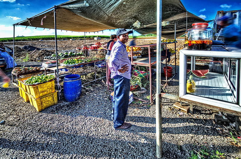 Local farmer selling the goods in Mauritius