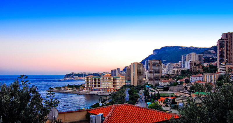 "Monaco is a sovereign city state on the French Riviera. It is bordered on three sides by its neighbour, France, and its centre is about 16 km (9.9 mi) from Italy. Its area is 1.98 km2 (0.76 sq mi) with a population of 35,986 as of 2011 and is the most densely populated country in the world. Monaco boasts the world's highest GDP nominal per capita at $151,630. Monaco also has the world's highest life expectancy at almost 90 years (CIA estimate, 2011), and the lowest unemployment rate at 0%, with about 40,000 workers who commute from France and Italy each day. Monaco is the second smallest country (by size) in the world; only the Vatican City is smaller.<br /> Monaco levies no income tax on individuals. The absence of a personal income tax in the principality has attracted to it a considerable number of wealthy ""tax refugee"" residents from European countries who derive the majority of their income from activity outside Monaco; celebrities such as Formula One drivers attract most of the attention, but the vast majority of them are less well-known business people. Monaco has a warm-summer Mediterranean climate (Köppen climate classification: Csa), which is influenced by the oceanic climate and the humid subtropical climate.<br /> As a result, it has warm, dry summers and mild, rainy winters. Cool and rainy interludes can interrupt the dry summer season, the average length of which is also shorter. Summer afternoons are infrequently hot (indeed, temperatures > 30 °C /86 °F are rare) as the atmosphere is tempered by constant sea breezes. On the other hand, the nights are very mild, this being due to the fairly high temperature of the sea in summer. Generally, temperatures do not drop below 20 °C in this season. In winter, frosts and snowfalls are extremely rare, generally occurring once or twice every ten years."