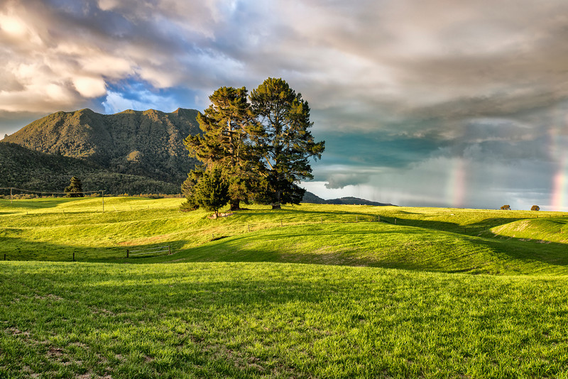 Sunset, Rain, Sun, Rainbows, Storm over Green New Zealand.