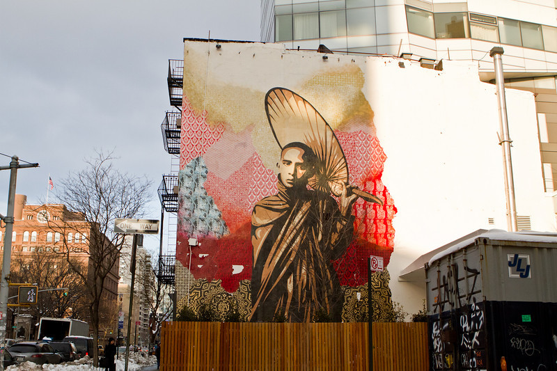 Insatallation Mural by artist Shepard Fairey. Fairey and members of Team OBEY edged fragments of the centerpiece, a pondering Burmese Buddhist Monk with umbrella.