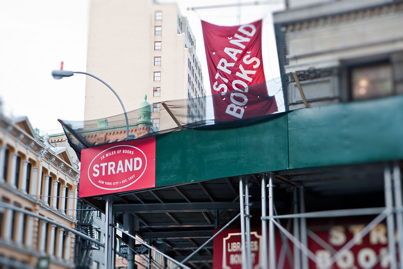 """STRAND Bookstore, a storied bookstore along Broadway. It may already be in the Greenwich Village area, but East Village residents are just a block away from this amazing bookstore. """"18 miles of Books."""" With enough patience, you can find cheap and used copies of some of your favorite books (I have some... :) ). Entrance to the store is located at the corner of 12th street and Broadway."""